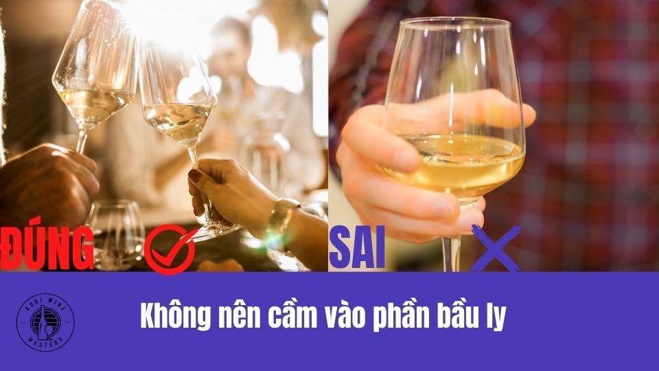 Không nên cầm phần bầu ly rượu vang